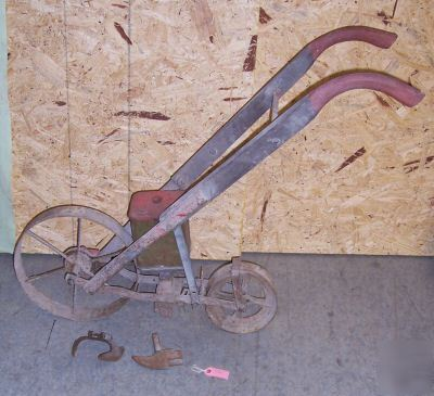 Antique Push Plow http://www.tennesseequipment.com/Midwest-/Missouri-/Cultivator-K721-plow-garden-flower-bed-planter.pl